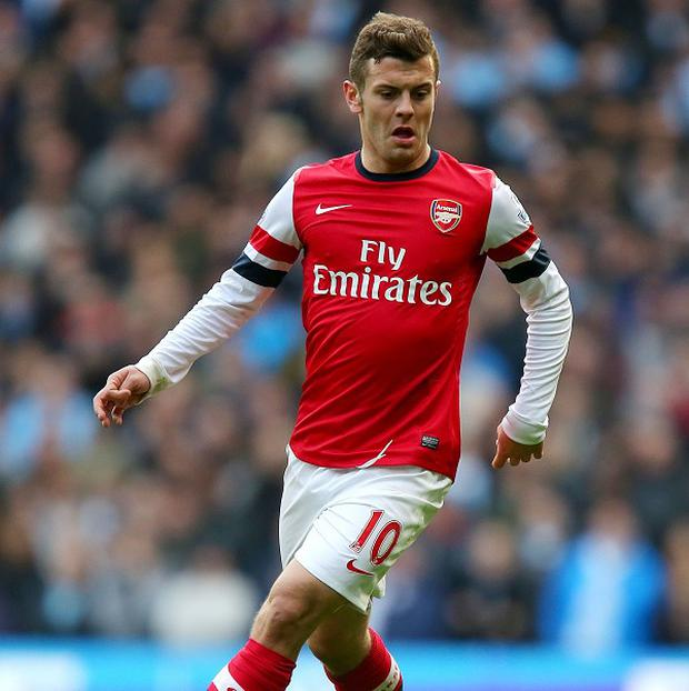 Jack Wilshere will serve a two-match ban over an offensive gesture towards Manchester City fans