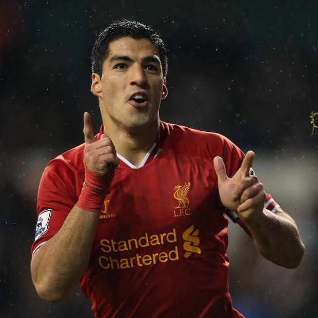 Luis Suarez has agreed new terms with Liverpool