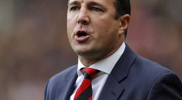 Malky MacKay gave a brief thumbs up to fans at Anfield
