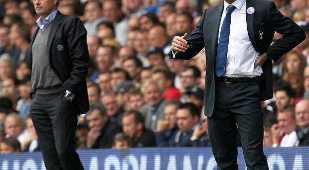 Jose Mourinho, left, spoke with Andre Villas-Boas after he was sacked by Spurs