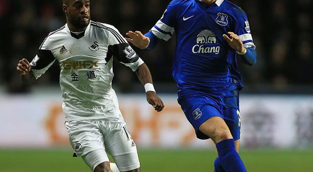 Swansea's Dwight Tiendalli, left, believes that Ross Barkley, right, is good enough to play for England