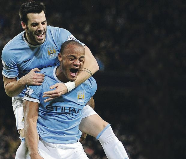 Manchester City's Vincent Kompany celebrates scoring his teams first goal against Liverpool with Alvaro Negredo