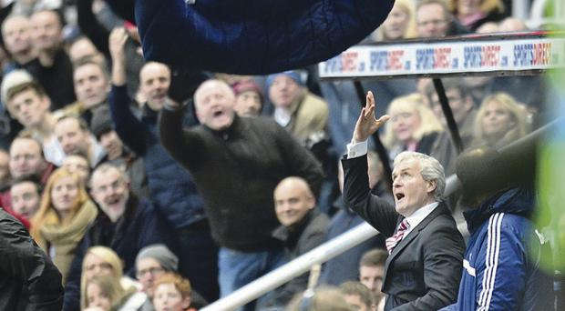 Frustration: Mark Hughes discards his coat after being sent off