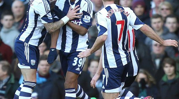 Nicolas Anelka, centre, scored twice against West Ham after returning to the West Brom team