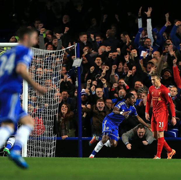 Samuel Eto'o celebrates scoring Chelsea's second goal