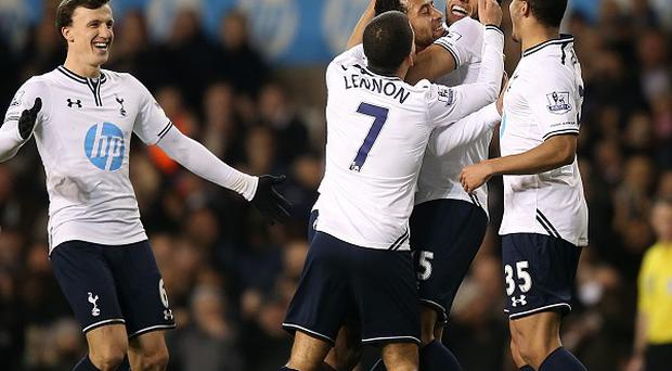 Mousa Dembele, centre, celebrates scoring the second goal