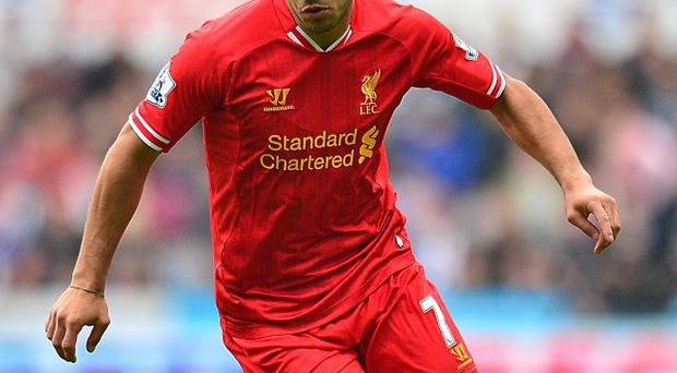 Luis Suarez, pictured, has been defended by Brendan Rodgers