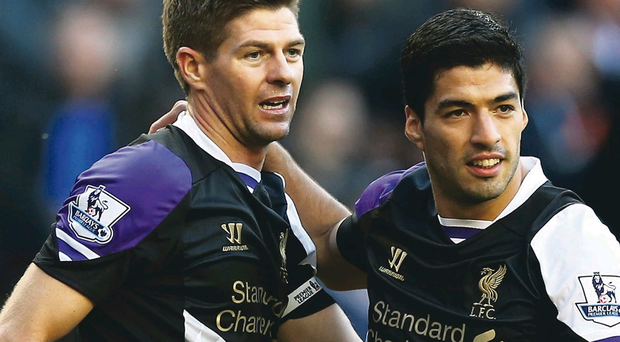 Luis Suarez (right) could be playing alongside Steven Gerrard again against Hull City
