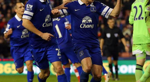 Leighton Baines converted a late penalty to give Everton a point