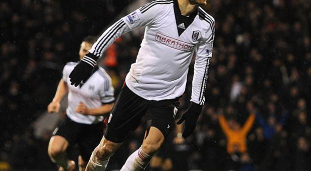 Dimitar Berbatov celebrates scoring the second goal