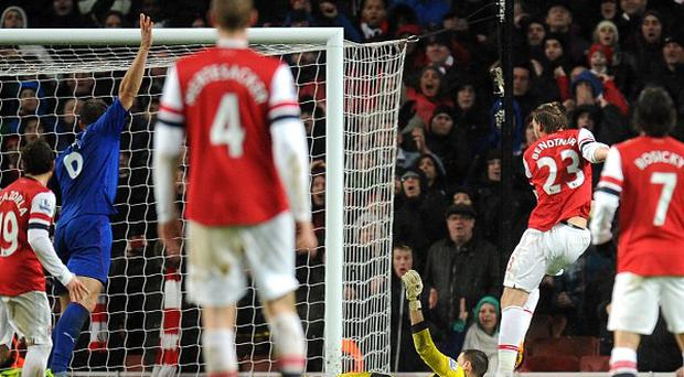 Nicklas Bendtner helped Arsenal back to the top of the table
