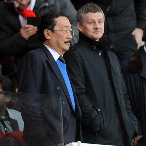 Ole Gunnar Solskjaer, right, watched Cardiff's defeat to Arsenal