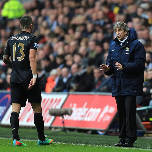 Manuel Pellegrini hailed his side's spirit at Swansea