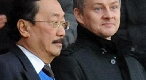 Ole Gunnar Solskjaer, right, is on the verge of being appointed as Cardiff manager