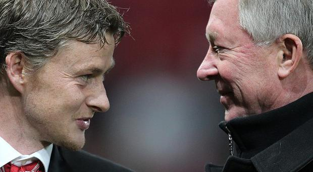 Sir Alex Ferguson, right, did not warn Ole Gunnar Solskjaer, left, off the Cardiff job by, according to the Norwegian