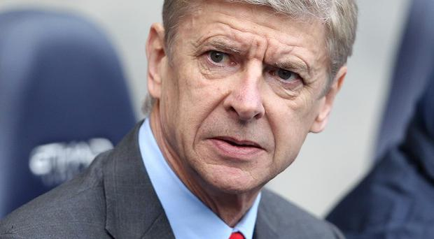 Injuries may force Arsene Wenger to dip into the transfer market this month