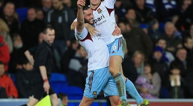 Andy Carroll, left, and Mark Noble, right, celebrate a rare West Ham win