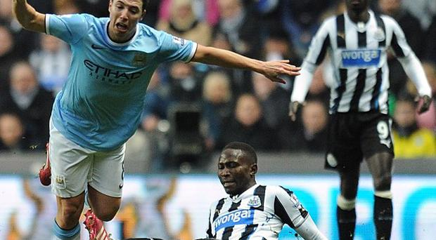 Mapou Yanga-Mbiwa, centre, was booked for the challenge that has sidelined Samir Nasri, left, for eight weeks