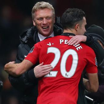 Robin van Persie, right, believes David Moyes, left, will get it right at old Trafford