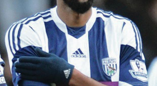 Charged: Nicolas Anelka makes the controversial gesture