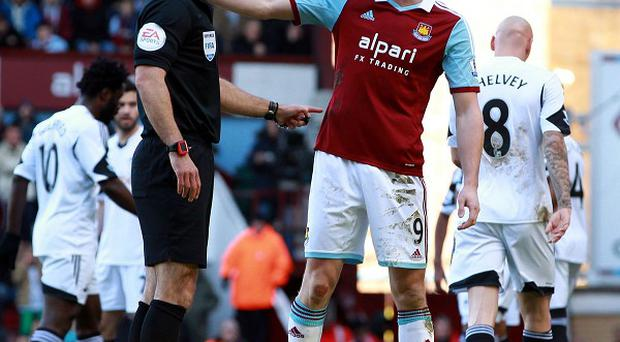 Andy Carroll, right, was sent off against Swansea