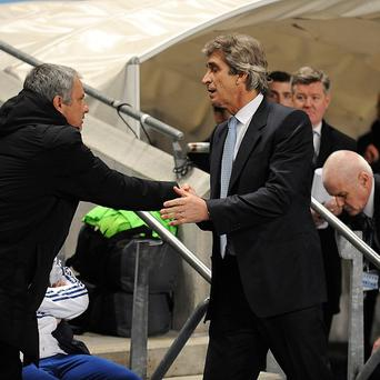 Manchester City's manager Manuel Pellegrini, right, does not agree with Chelsea manager Jose Mourinho, left, that the Blues are a