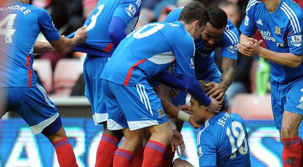 Nikica Jelavic is mobbed by team-mates after getting the second goal