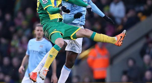 Yaya Toure, left, appeared to kick Ricky van Wolfswinkel, right, in Saturday's goalless draw at Carrow Road