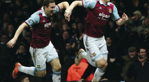 Late late show: James Collins (right), after putting West Ham in front late on, takes the congratulations from Stewart Downing