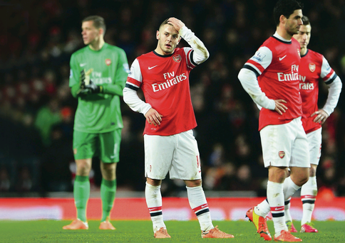 Head scratching: Jack Wilshere (left) and Mikel Arteta were two Arsenal players who flopped against United