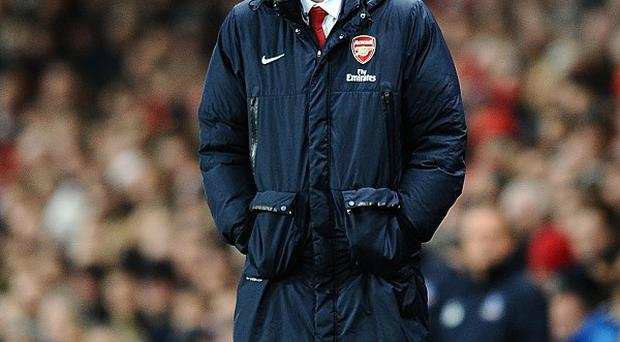 Arsenal boss Arsene Wenger believes the title is Chelsea's to lose