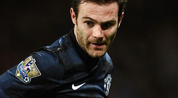 Juan Mata, pictured, has been backed to shine for Manchester United by team-mate Wayne Rooney
