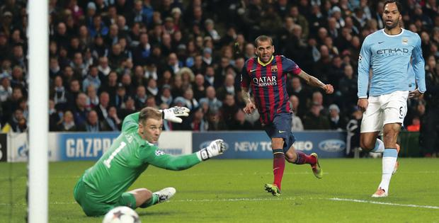 Barcelona's Dani Alves makes it 2-0 against Manchester City at the Etihad