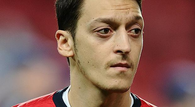Arsene Wenger wants to see Mesut Ozil, pictured, become an Arsenal great