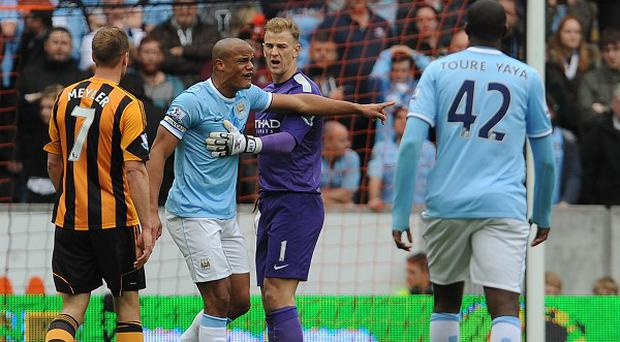 Vincent Kompany, second left, was given his marching orders against Hull