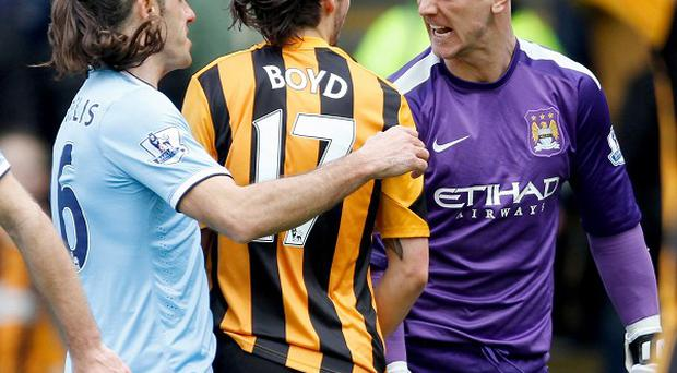 Joe Hart, right, and George Boyd square up during Manchester City's win at Hull
