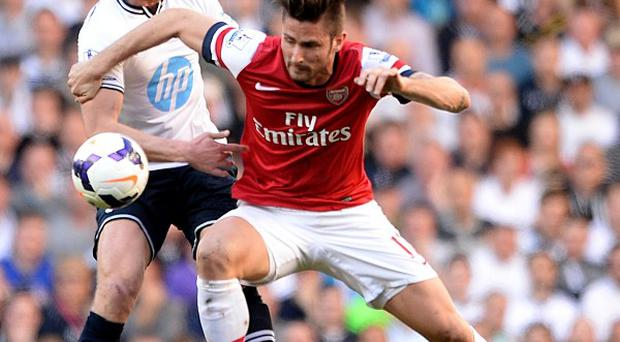 Jan Vertonghen, left, played for Tottenham in their defeat to Arsenal on Sunday