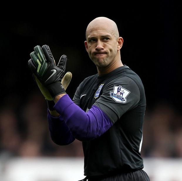 Everton goalkeeper Tim Howard, pictured, has backed Manchester United manager David Moyes to succeed at Old Trafford