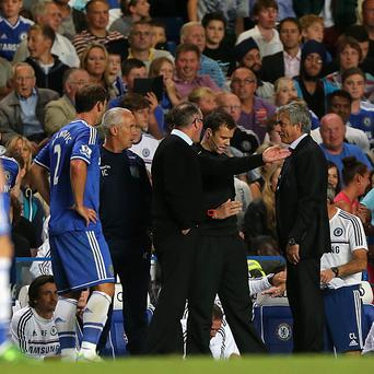 Chelsea manager Jose Mourinho (right) argues with Aston Villa boss Paul Lambert on the touchline
