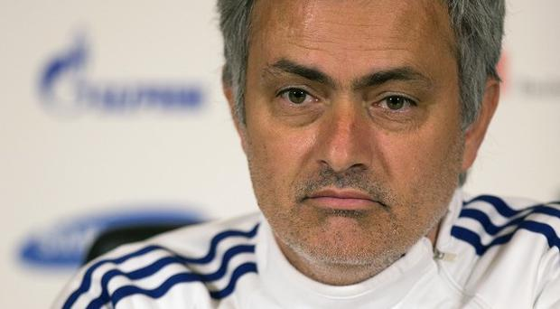 Jose Mourinho, pictured, reminded Arsene Wenger of his barren run without a trophy
