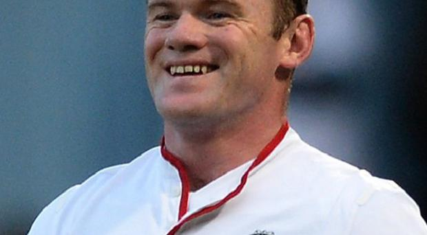Wayne Rooney scored twice in Manchester United's comfortable victory at Upton Park