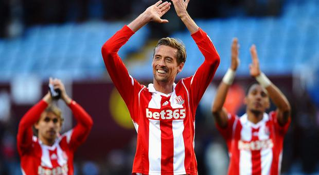 BIRMINGHAM, ENGLAND - MARCH 23: Peter Crouch (C) of Stoke and teammates celebrate following their team's 4-2 victory during the Barclays Premier League match between Aston Villa and Stoke City at Villa Park on March 23, 2014 in Birmingham, England. (Photo by Laurence Griffiths/Getty Images)