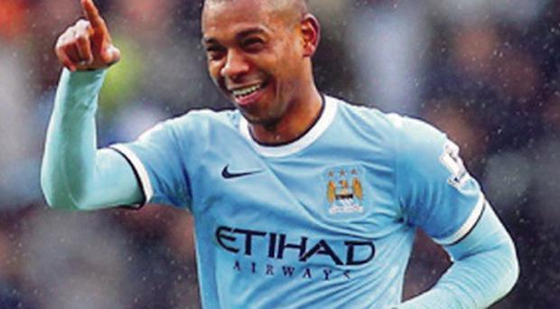 Fernandinho of Manchester City celebrates scoring their fourth goal during the Barclays Premier League match between Manchester City and Fulham at Etihad Stadium on March 22