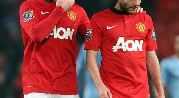 Manchester United's Wayne Rooney, left, admits sides no longer fear coming to Old Trafford