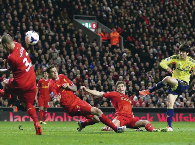 Nervous moments: Sunderland's Ki Sung-Yeung gives Liverpool a late scare during last night's Premier League game at Anfield