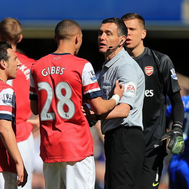 Referee Andre Marriner, pictured right, has struggled to get over his incorrect decision to dismiss Arsenal's Kieran Gibbs, centre left