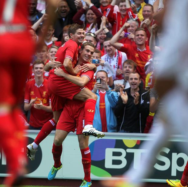 Jordan Henderson, right, says Steven Gerrard, left, deserves to win the title
