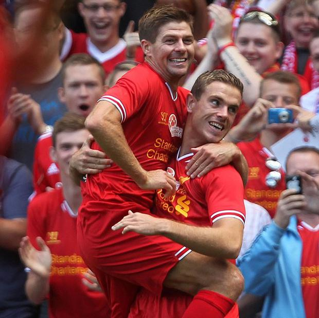 Jordan Henderson, right, wants to help Steven Gerrard, left, claim an elusive Premier League winner's medal
