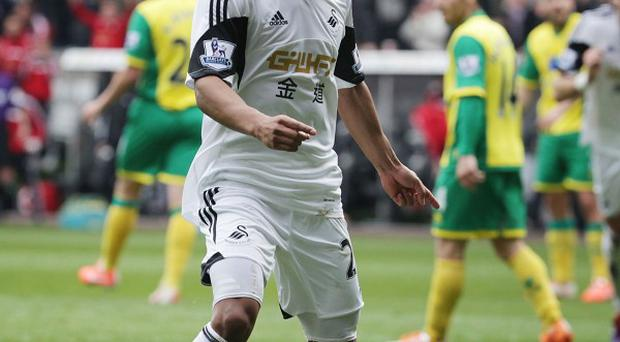 Jonathan de Guzman netted twice in a much-needed win for Swansea