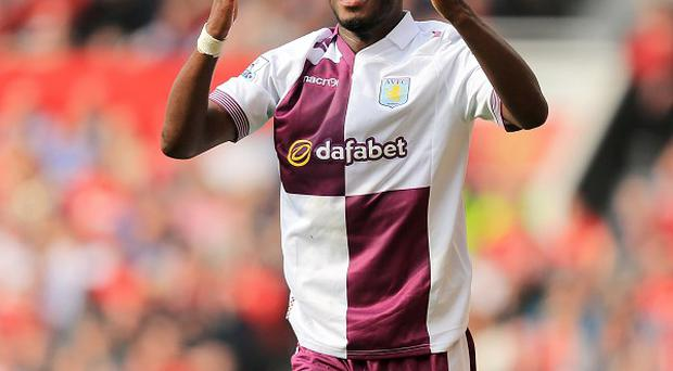 Aston Villa's Belgium international striker Christian Benteke is nervously awaiting the result of a scan on a suspected Achilles injury